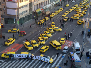 Taxis drivers in Budapest protest against Uber. Photo credit: APTOPIX Hungary