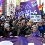 """Demonstrators shout slogans as they hold flags, placards and a banner during the """"March for Change"""" planned by left-wing party Podemos that emerged out of the """"Indignants"""" movement, in Madrid on January 31, 2015. Tens of thousands of people took to the streets in Madrid today in support of a call for change from new anti-austerity party Podemos, a week after Greece elected its ally Syriza. AFP PHOTO/ GERARD JULIEN (Photo credit should read GERARD JULIEN/AFP/Getty Images)"""