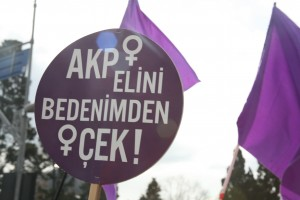 Turkish feminists protest AKP's policies on abortion with the sign: 'AKP hands off my body. Source: Sendika