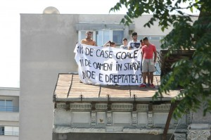 """Community members protesting in the day of the eviction. """"Thousands of empty houses, Thousands of people in the street, Where is the Justice?"""""""
