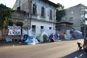 """View from a part of the camp . Banner reads: """"The street is not a Home!"""""""